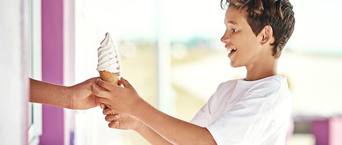 Enjoying happiness in a cone - ice cream truck Sydney hire