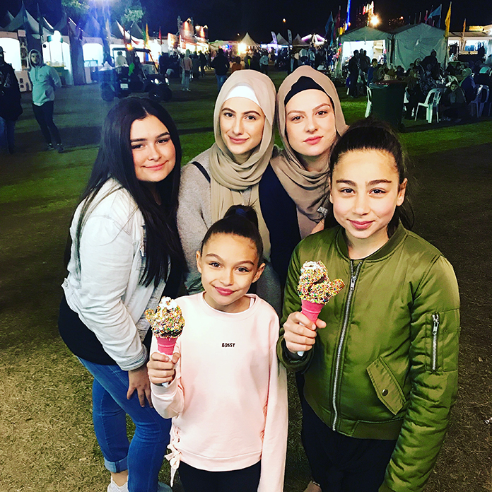Family eating ice cream at fun fair
