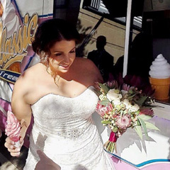 A happy bride at her wedding with the Classic Soft Serve ice Cream Van