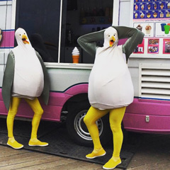 Penguins partying in front of the Classic Soft Serve Ice Cream van, Sydney, NSW